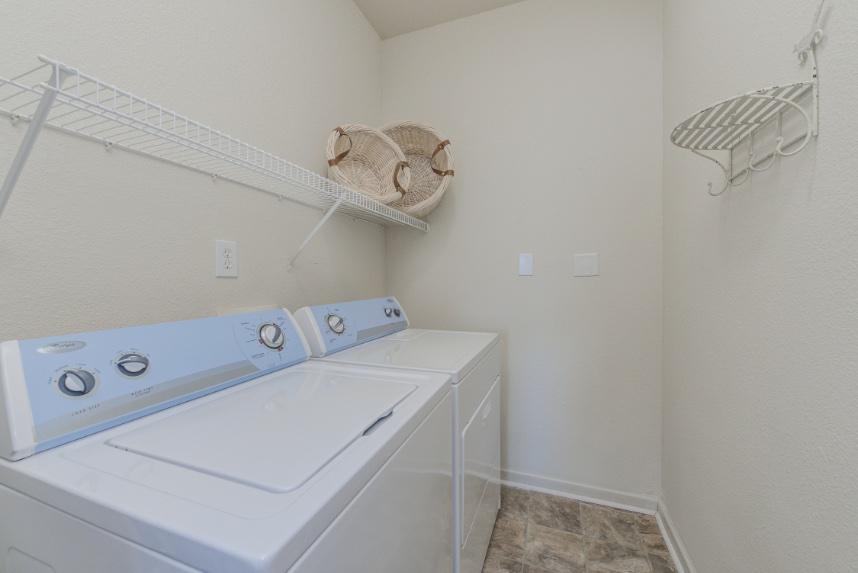 Laundry room with storage space in Sylvania.